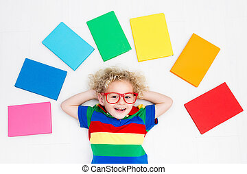 Child reading books. School for kids. - Little boy with...