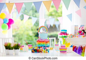 Kids birthday party decoration and cake. Decorated table for...