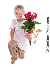 Boy on his knees with flowers