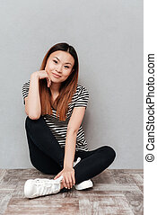 Calm positive woman looking camera - Calm positive asian...