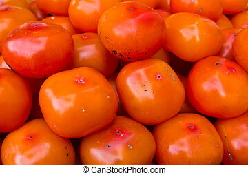 persimmon - The orange vivid crowd of persimmon fruit.