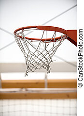 Basketball hoop in sport school gym hall