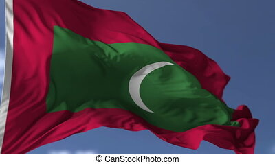 Flag of Maldives blowing on the wind, close up looped...