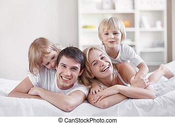 Happiness - Smiling parents with children at home