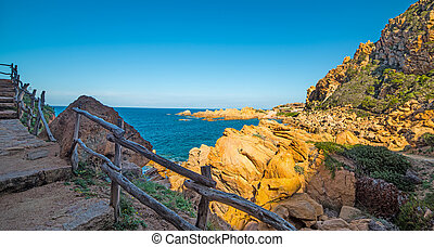 Wooden handrail in Sardinia - Costa Paradiso in spring,...