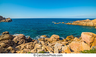 Blue sea and orange rocks - Costa Paradiso in spring,...