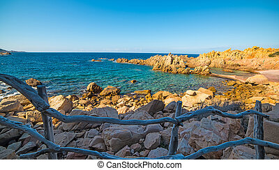 Handrail and blue sea - Costa Paradiso in spring, Sardinia