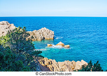 Grey rocks and blue sea - Costa Paradiso in spring, Sardinia