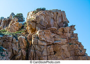 Orange cliff in Sardinia - Costa Paradiso in spring,...
