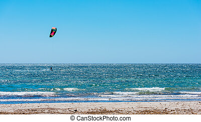 Kite surfing on a clear day