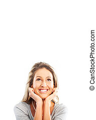 Dreaming - Beautiful smiling dreaming woman. Isolated over...