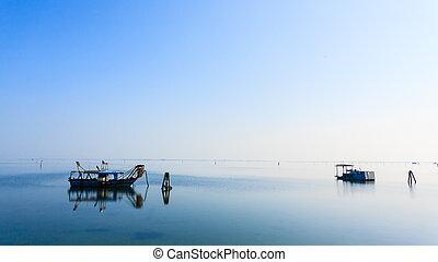 Fishing boats from Po river lagoon, Italy - Fishing boats...