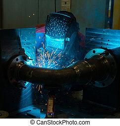 Welder working with steel