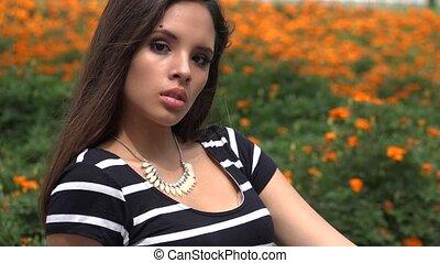Unemotional Hispanic Teen Female