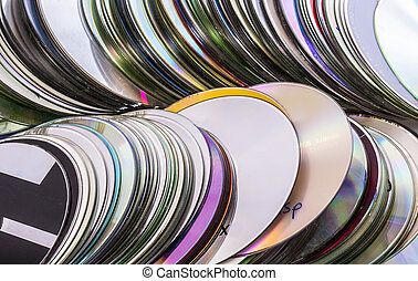 Loads of old used cd disks. Isolated over white background
