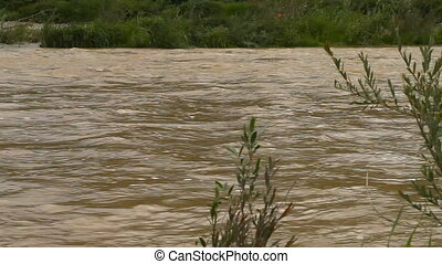 River burst its banks. Muddy water - River burst its banks....