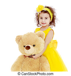Little girl hugging Teddy bear - Joyful little girl...