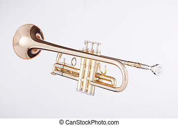 Trumpet Isolated On White - A gold trumpet isolated against...