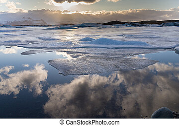 Frost winter lake with blue sky reflection, Iceland natural...