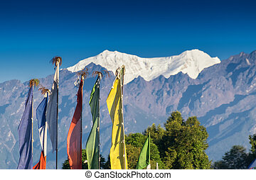 Buddhist prayer flags , India - Mount South Kabru (left) and...
