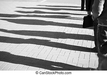 People standing in a queue - Shadow of a people standing in...