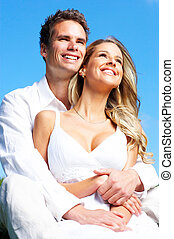 couple - Young love couple smiling under blue sky