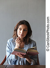 Thinking woman reading book. - Photo of thinking woman...
