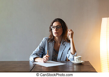 Thoughtful woman writing notes. - Picture of thoughtful...