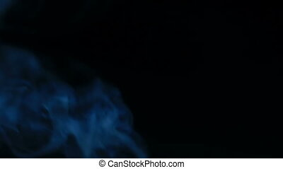 Smoke blur and flowing over dark Abstract background with grain