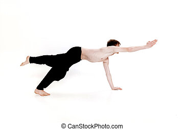 Young man doing yoga exercises. Studio shot on white background