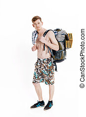 Young hiker with backpack on white background