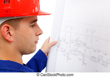 Young construction engineer surveying plans - Young...