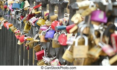 Fabulous forged metal fence covered with love padlocks on a river bank in Prague