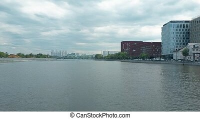 Low altitude aerial shot of Moscow river within industrial...