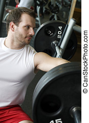 Young man relaxing on bench press