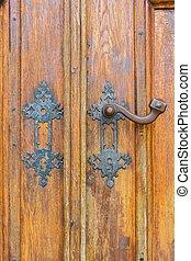Part of vintage old wooden door with door knob