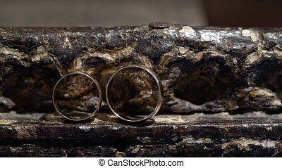 Two wedding rings on stone table