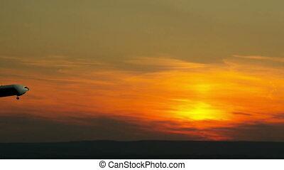 Airplane takeoff into evening sky - Airplane silhouette...