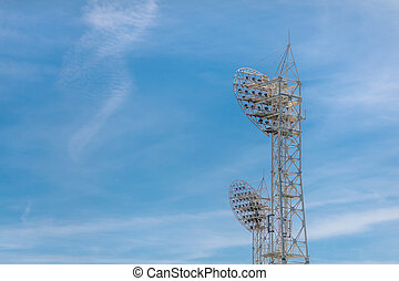 Stadium light against blue sky. Sports architecture and...