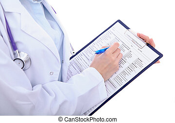 Close up of a female doctor filling up medical history form, just hands