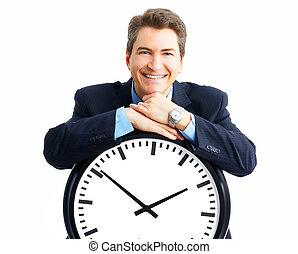 Handsome businessman holding a clock. Over white background...