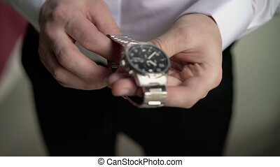 Man wears wrist watches closeup