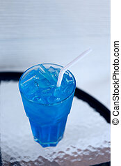 Ice Blue Hawaii in glass on table. - Ice Blue Hawaii in...