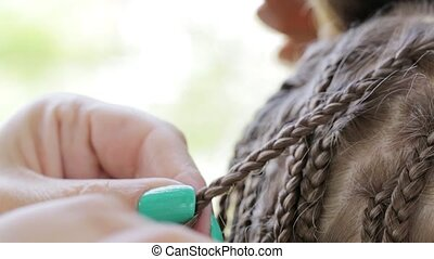 Hands stylist braid dreadlocks girl teen outdoor