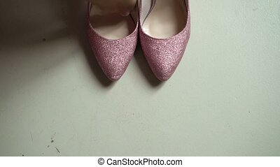 Woman wearing pink shoes indoors