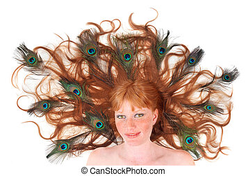 Pretty red-head woman with peacock feathers in her hair -...
