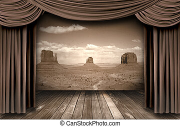 Hanging stage theater curtains with a desert background -...
