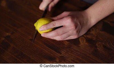 Sliced lemons for lemonade. On a wooden board red hue.