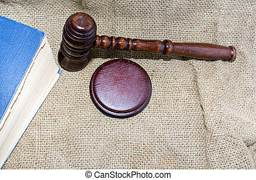 wooden gavel and book on the old bag
