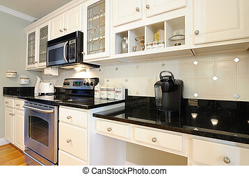 Modern furniture - Home kitchen with black marble tops